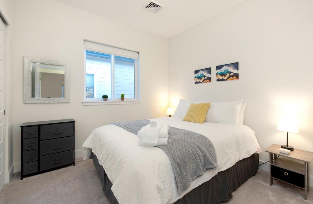 Bedroom 1: Queen bed on second level