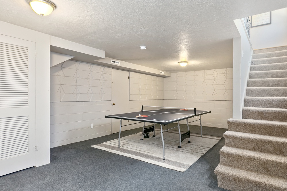 Ping Pong table in basement for kiddos to play and family to hang out