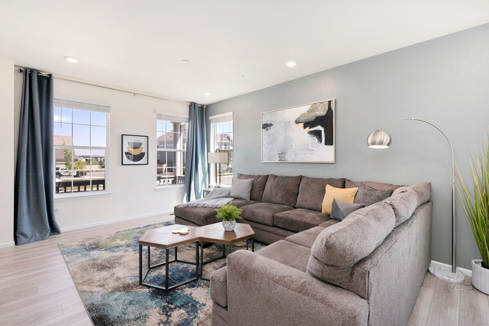 Comfy living area with ample seating and a 55