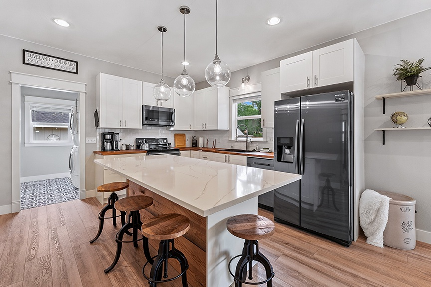 Kitchen with bar top and seating for 4