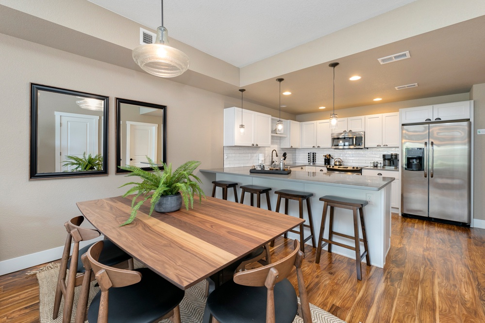 Open concept with dining table for 6 and bar top seating for 4