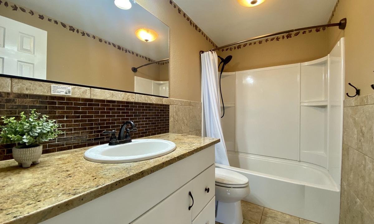 Bathroom 1: full bath on main floor