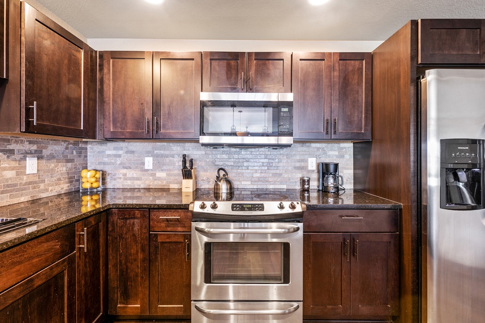 Lovely kitchen with granite countertops and stainless steel appliances