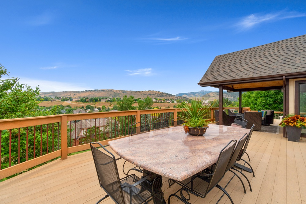 Outside dining on main floor deck offering up incredible views