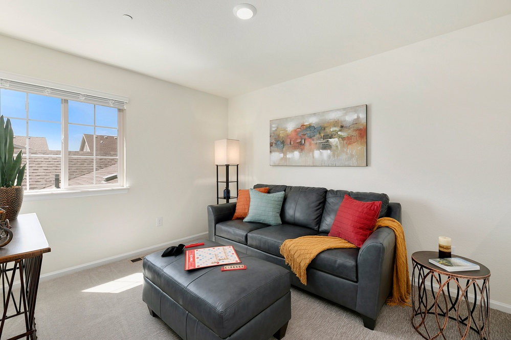 second floor loft with games and queen sized pull out couch