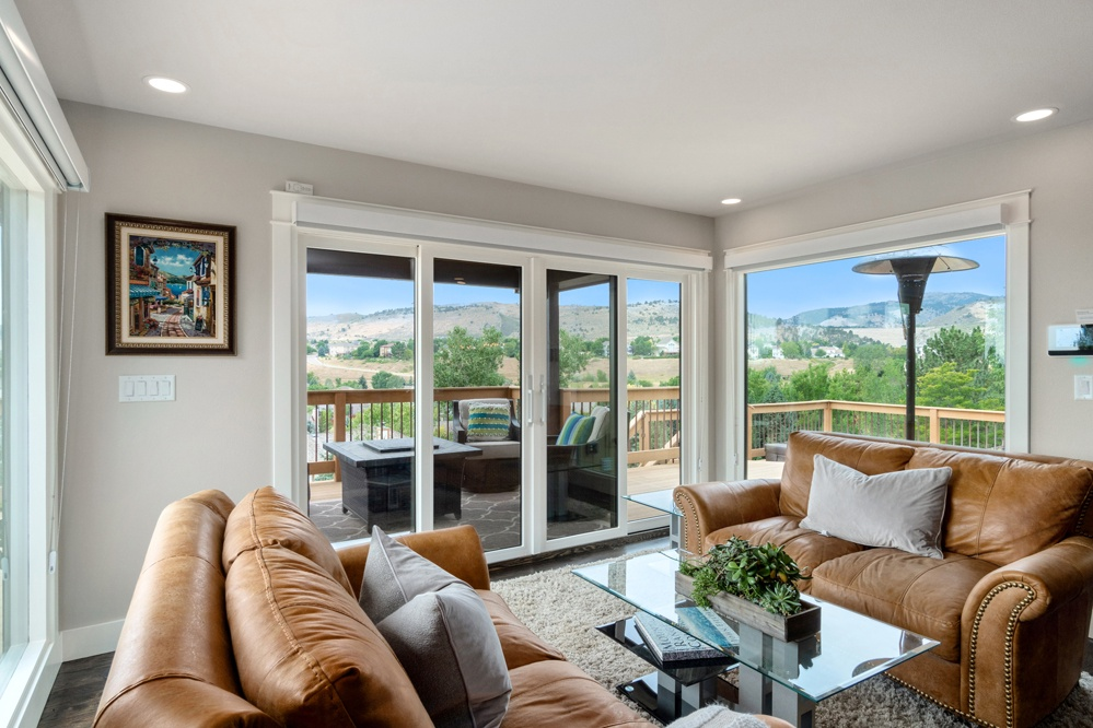 Sitting area with views of foothills and access to covered deck
