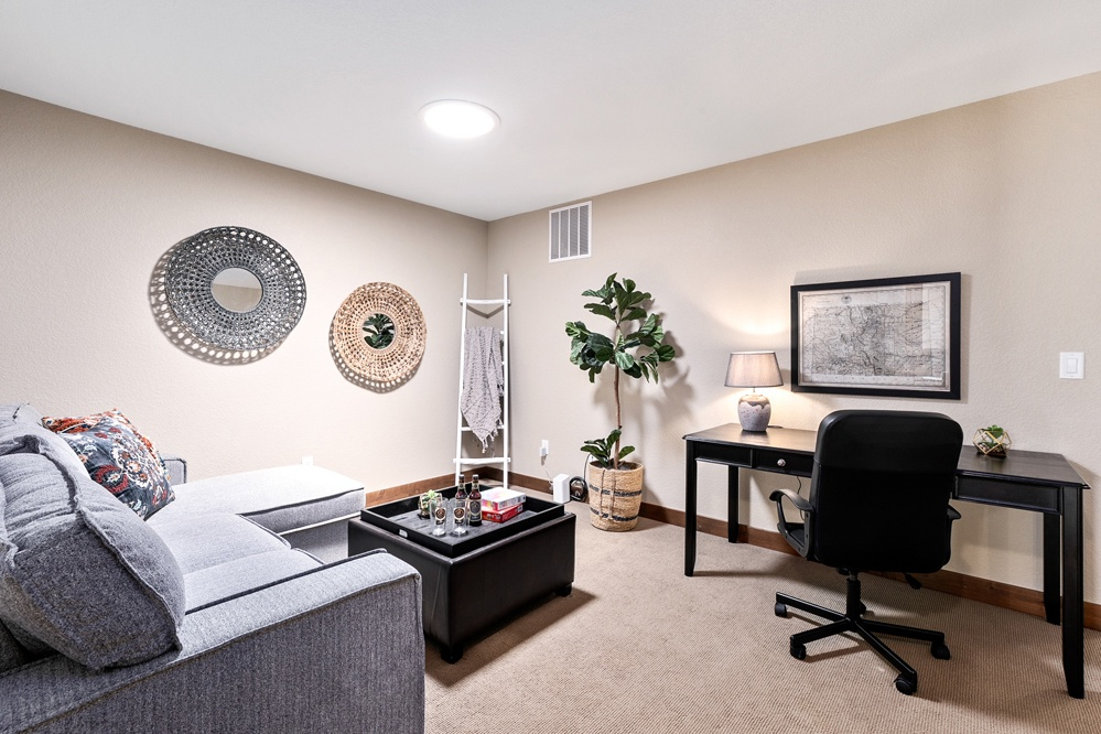 den upstairs with desk and games