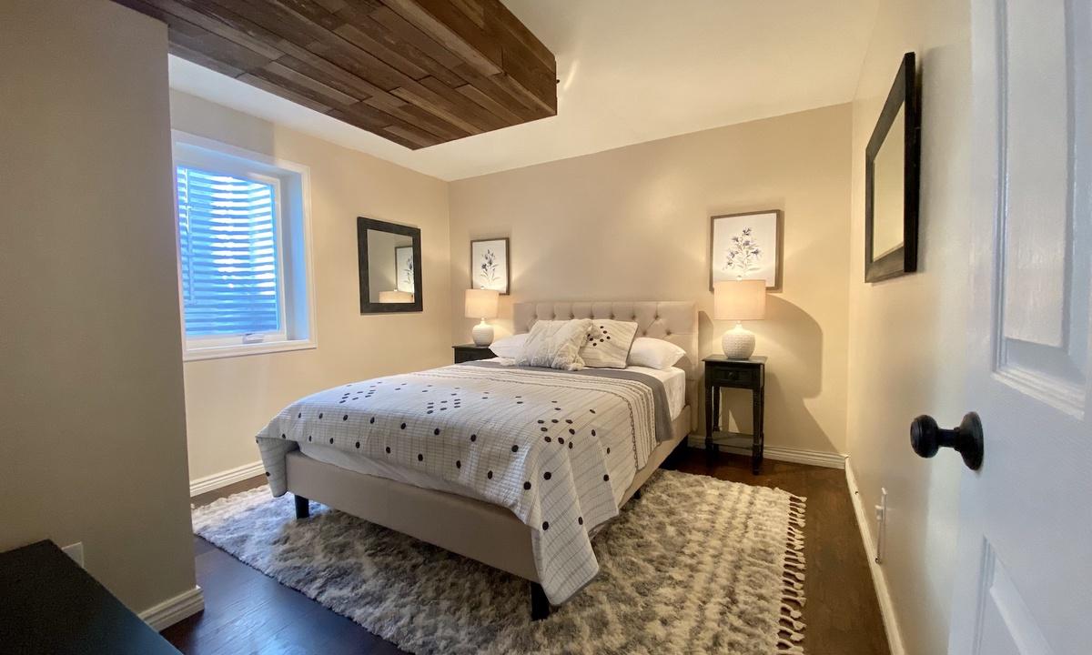 Bedroom 4: Queen. Downstairs.
