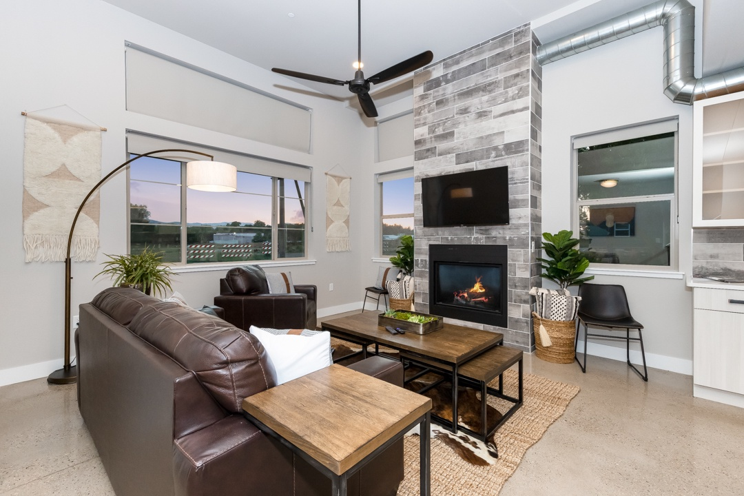 Open concept living room with gas fireplace and smart TV