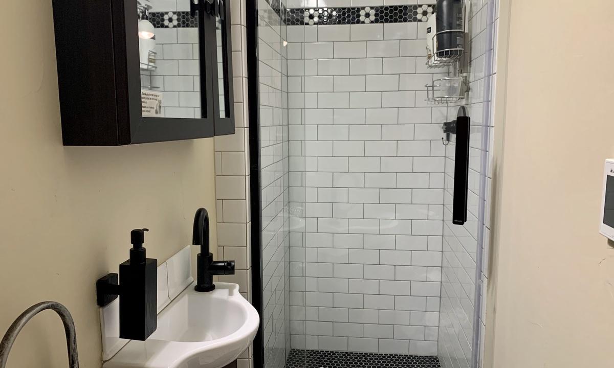 Beautifully remodeled European style efficiency bathroom
