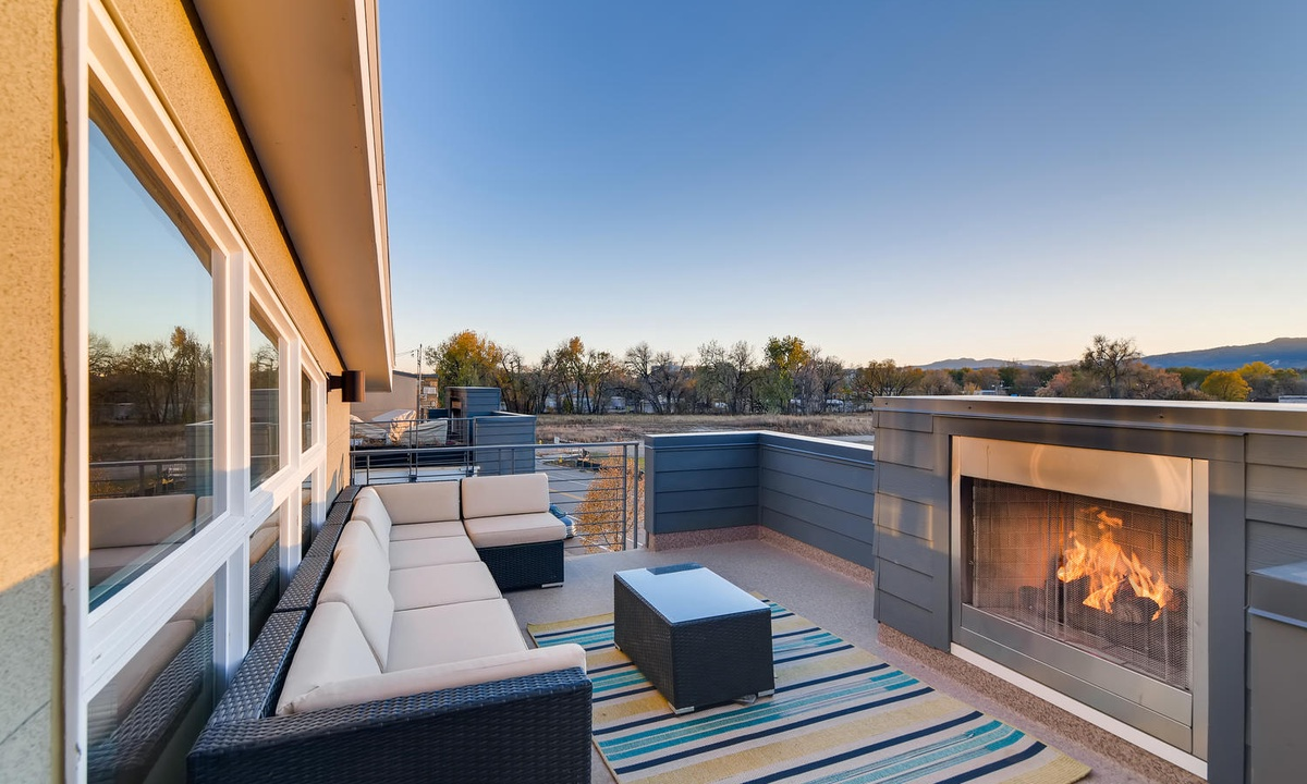 3rd floor rooftop terrace with fireplace and mountain views.