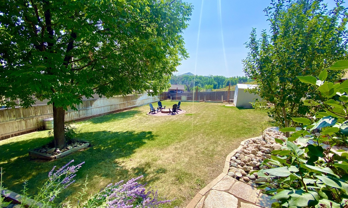 fenced in side yard and fire pit