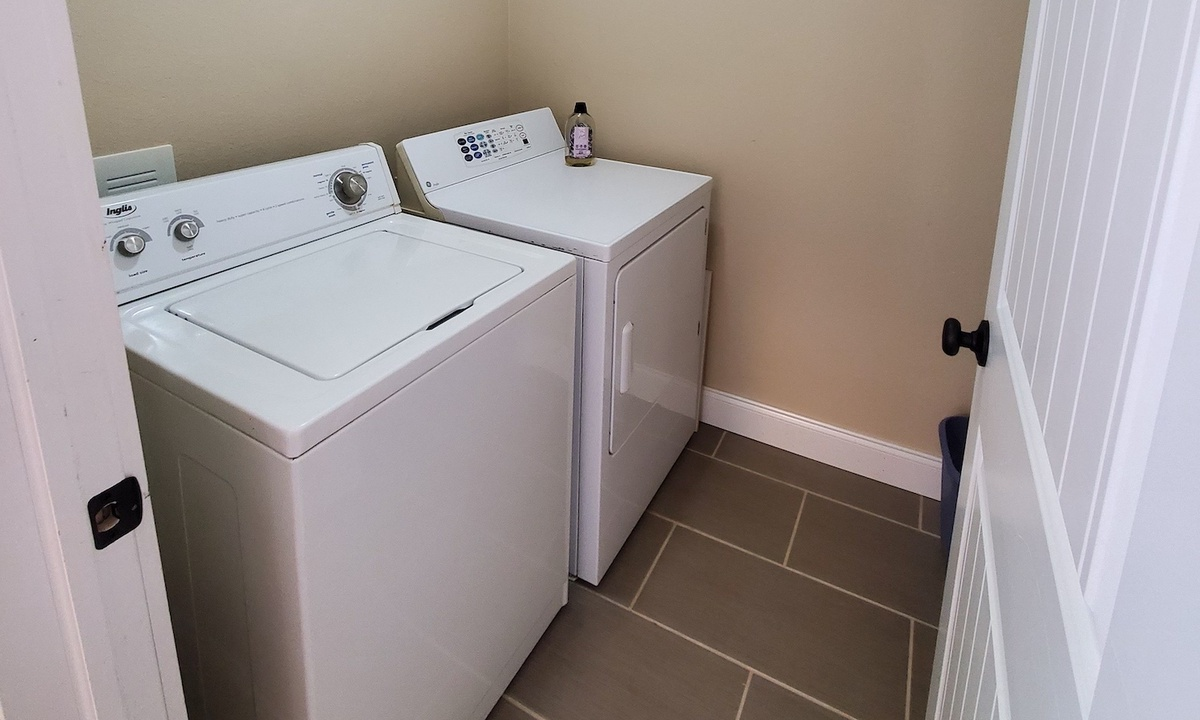 Private laundry room in guest suite