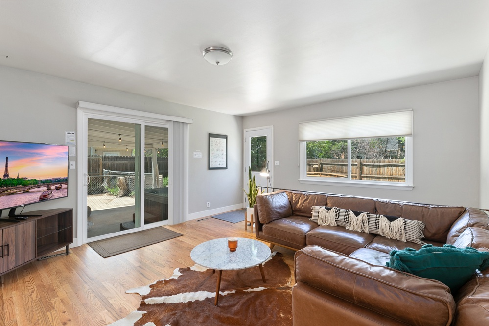 Living room with perfect access to the covered patio and hot tub