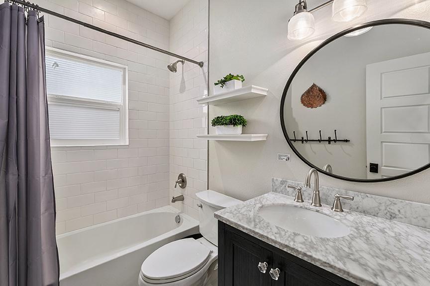 Bathroom 2: bath/tub shower.