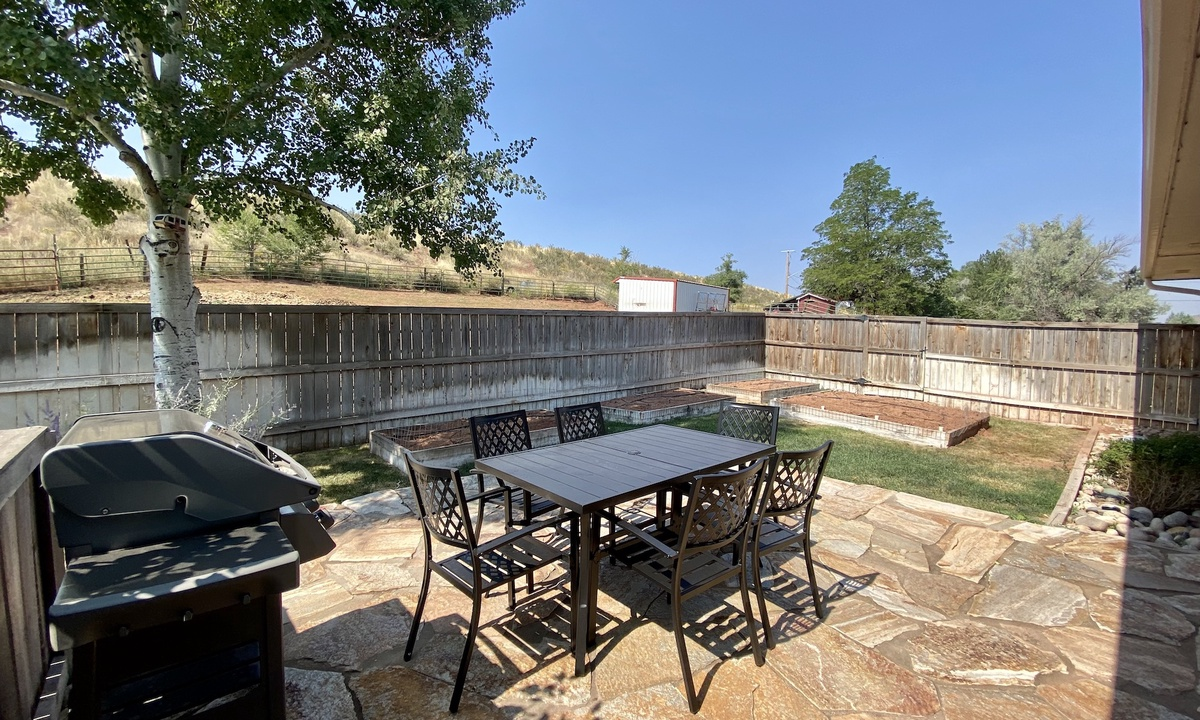 Grill and patio set off of kitchen
