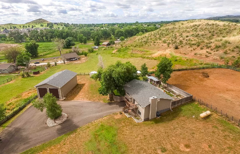 This beautiful homes sits on an acres of land.