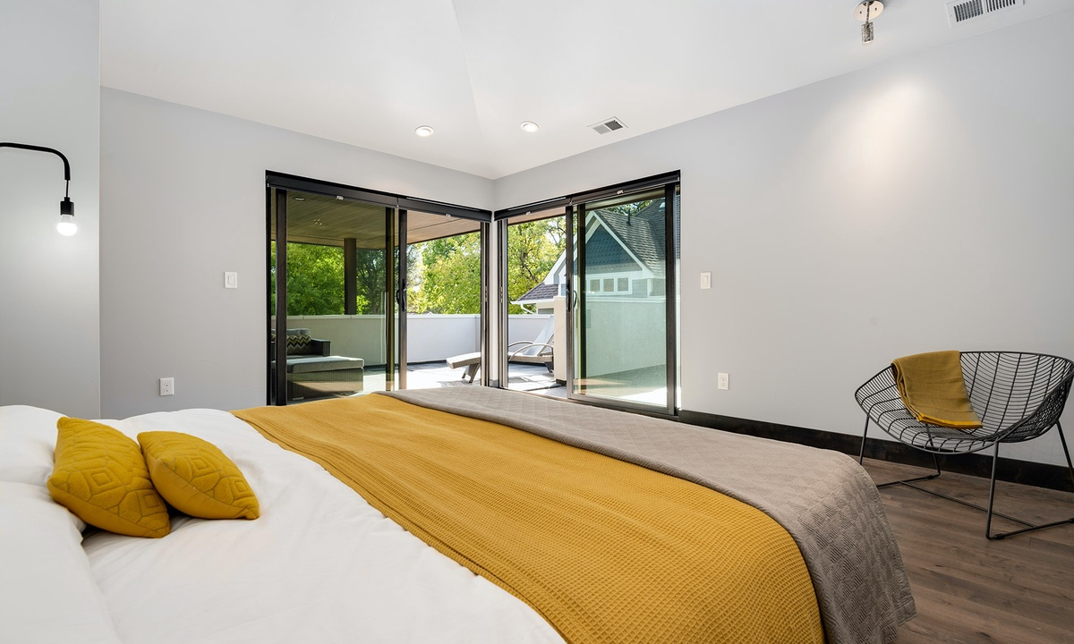 Master bedroom upstairs with King bed , ensuite bath and deck with hot tub.