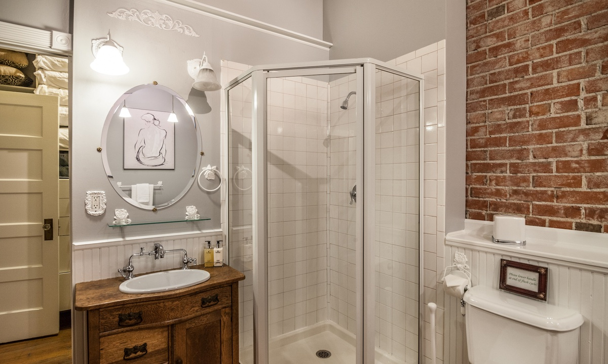 Full bathroom with shower and clawfoot tub