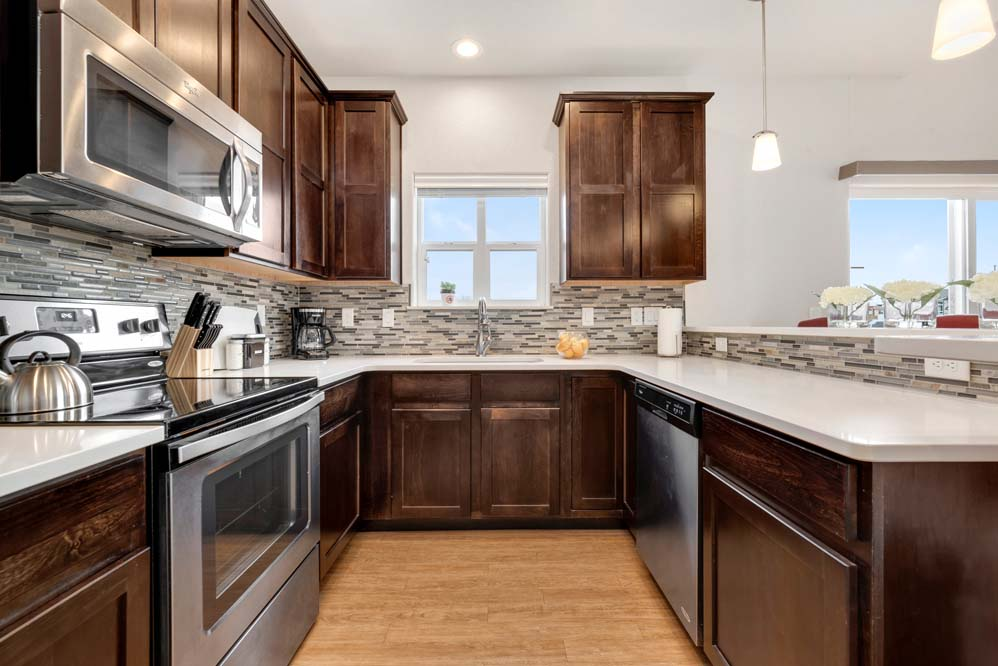 Chef's kitchen with stainless steel appliances