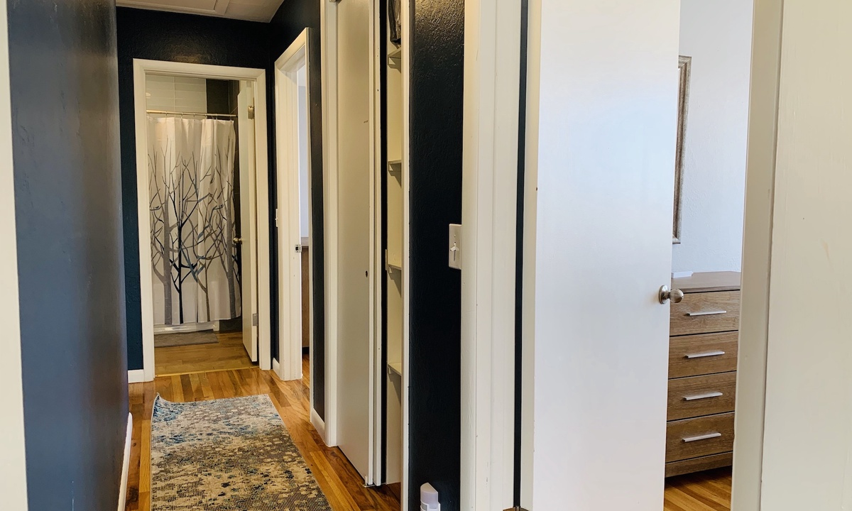 Hallyway leading to both bedrooms and bathroom