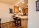 Kitchen Counter w/Seating-Skyline Condo 13