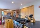 Kitchen w/Gas Stove-Sharp Place 55872